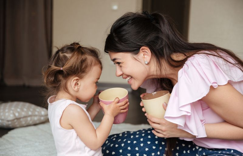 Mom and daughter drinking tea